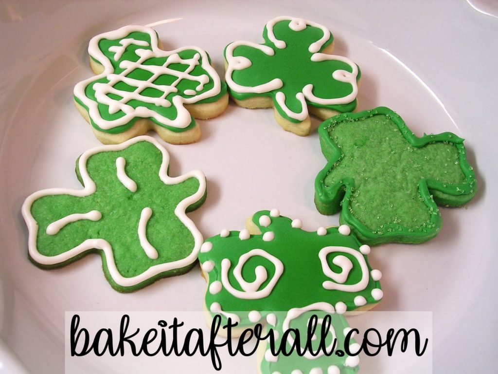 St. Patrick's Day Sugar Cookies with Royal Icing in a pie plate serving platter