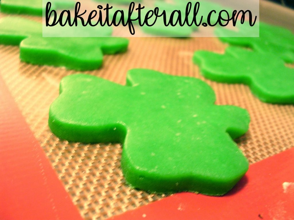 green shamrock cookie dough shapes on a silpat
