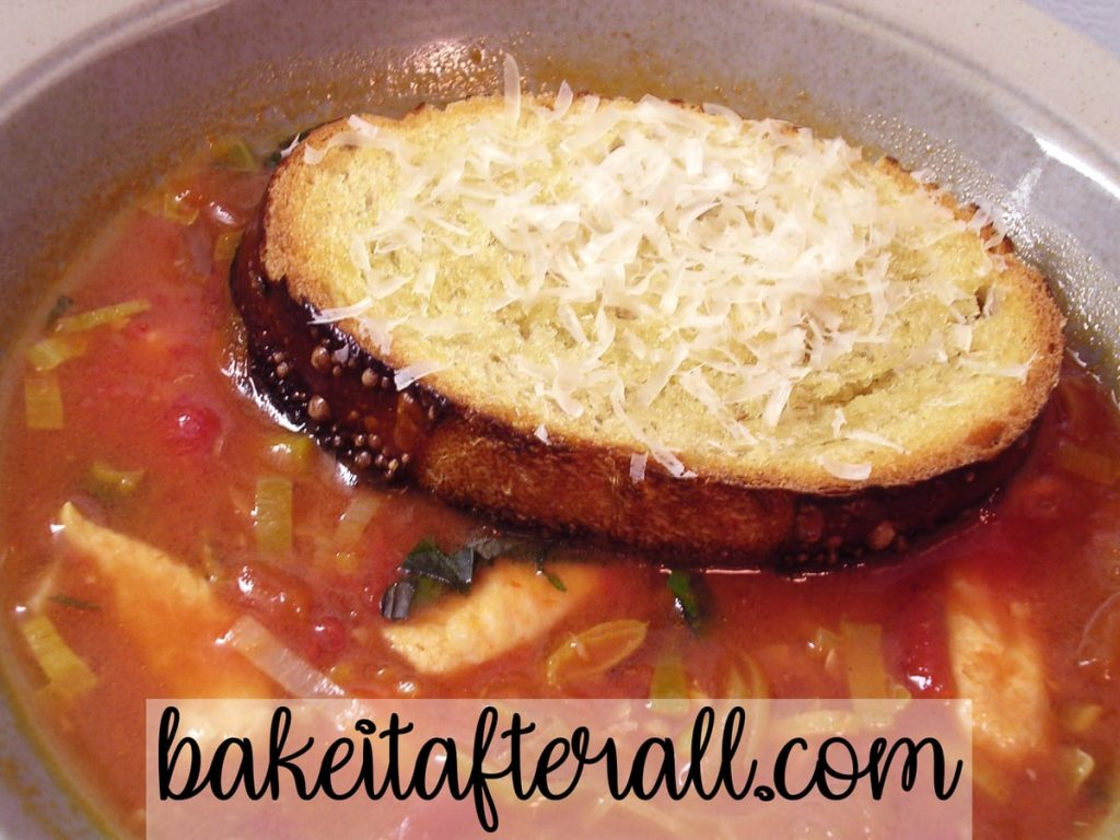 Chicken, Leek and Tomato Soup with toast on top