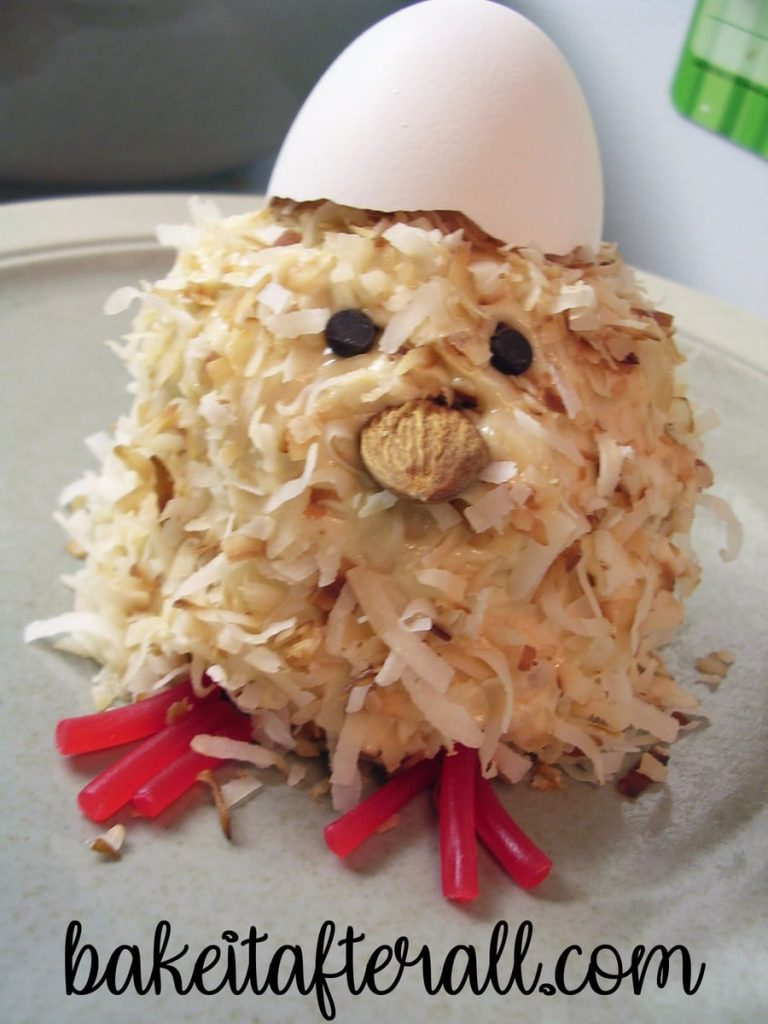 spring chicken cupcake with an egg on its head