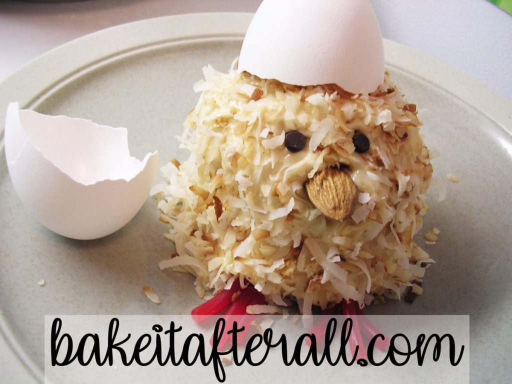 spring chick cupcake with an egg shell on its head