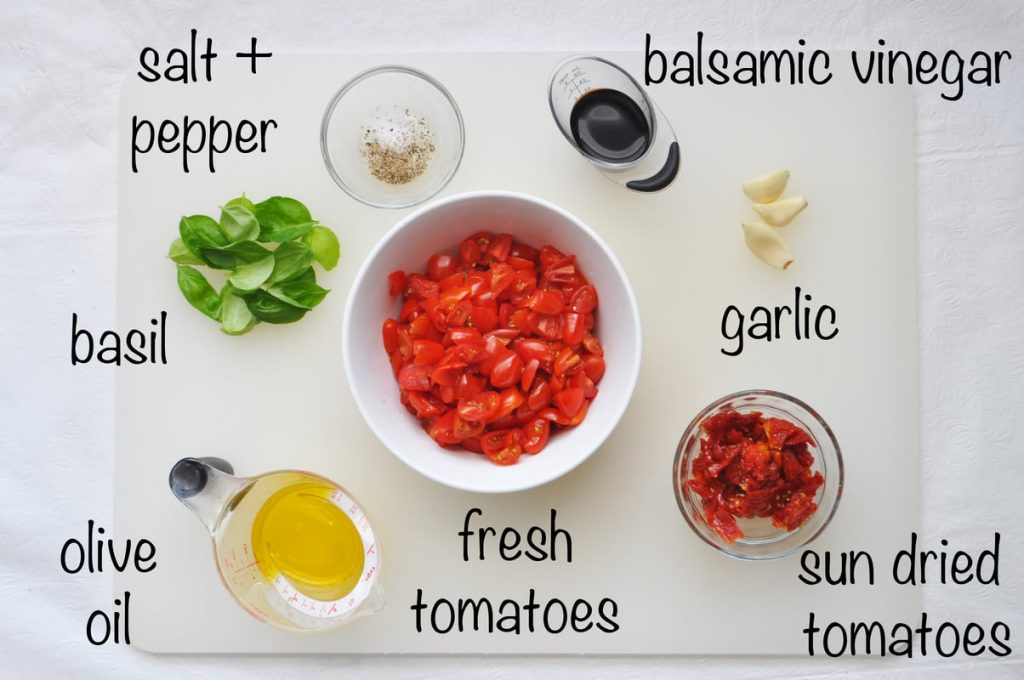 tomato mixture ingredients all laid out in an aerial shot