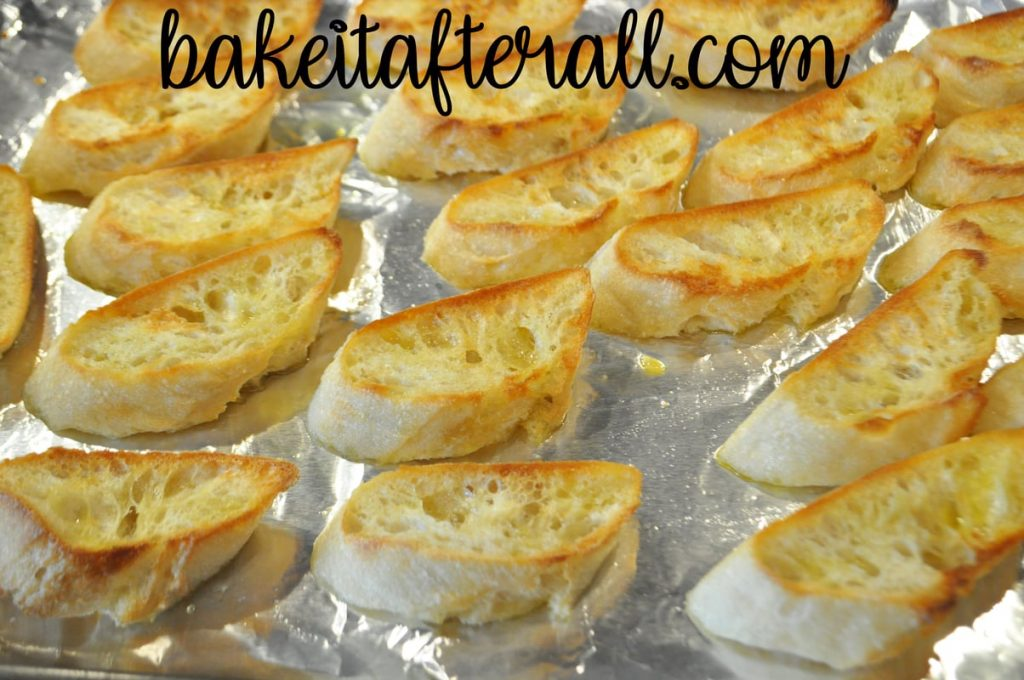 toasted bread slices on a sheet pan
