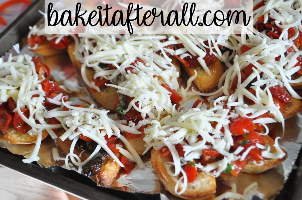 slices of bread topped with tomato mixture and shredded cheese on top before baking