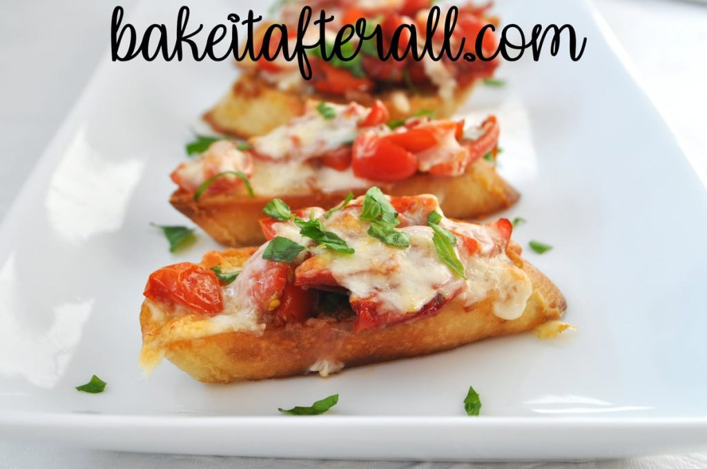 double tomato bruschetta on a white plate