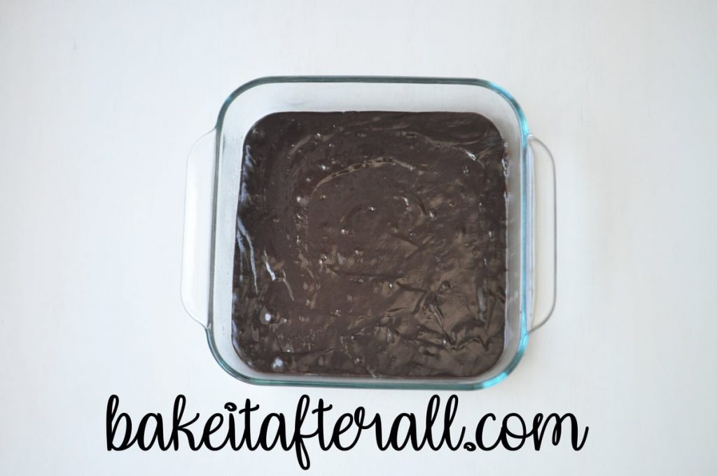 brownie batter in a square baking dish