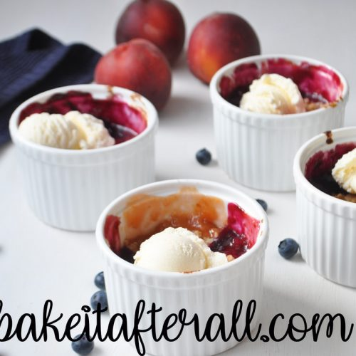 Peach Blueberry crumbles with vanilla ice cream on top
