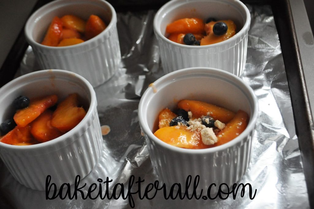 peach blueberry crumbles in ramekins before baking