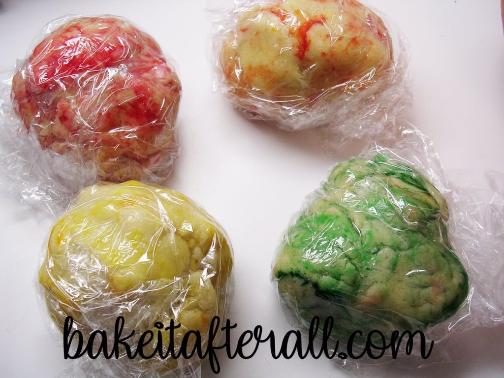 balls of cookie dough dyed with fall colors
