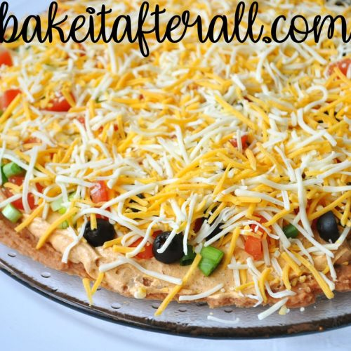 Layered Taco Dip on a platter