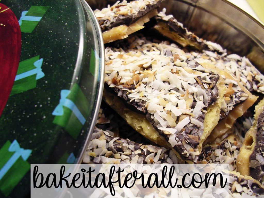 Candy with toasted coconut on top in a holiday tin
