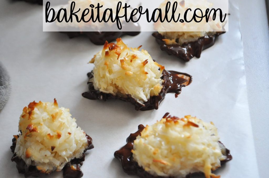 cookies dipped in chocolate setting on parchment paper