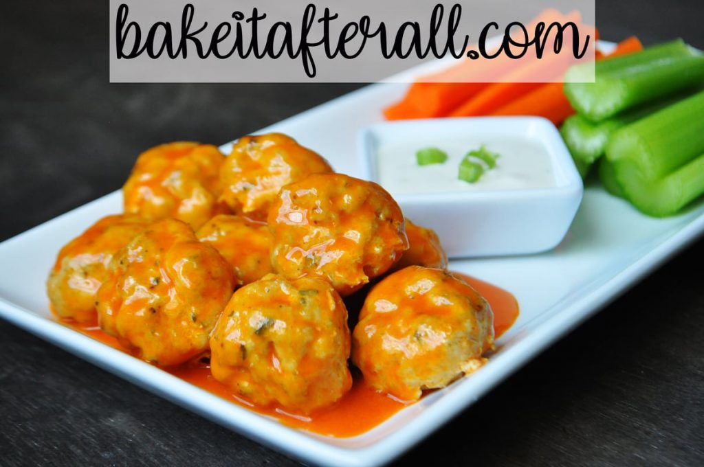 Buffalo Chicken Meatballs with dressing and carrots and celery sticks