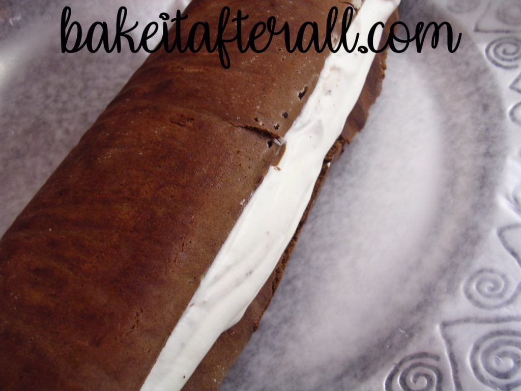 rolled cloud roll cake with whipped cream inside