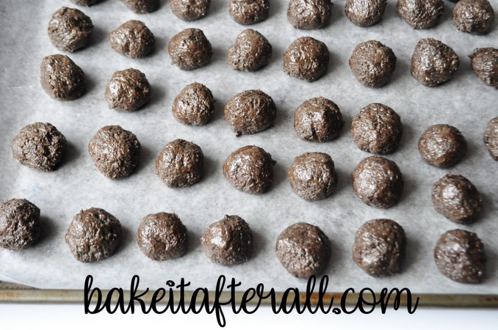 oreo balls on waxed paper lined baking sheet ready to be chilled