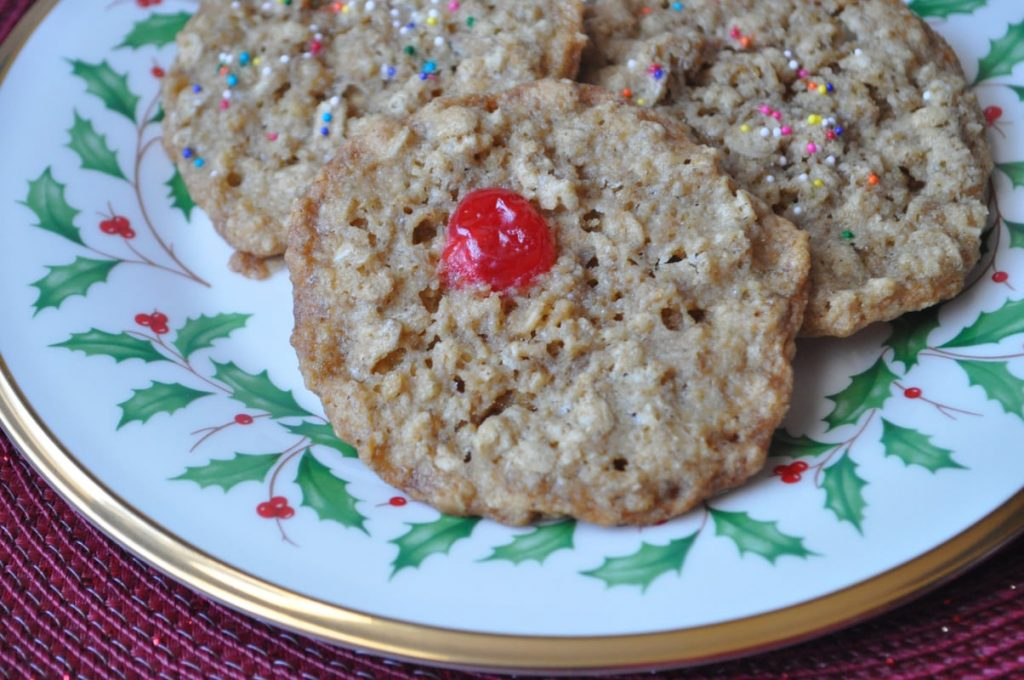 Chewy Oatmeal Cookies with a red maraschino cherry in the center