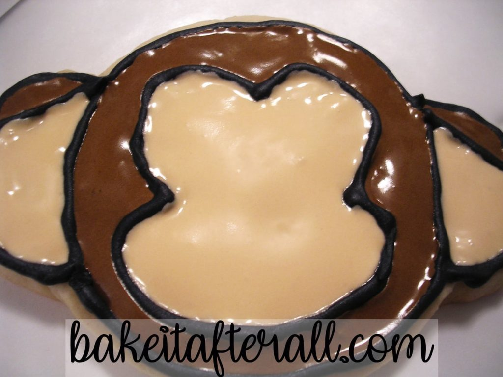 Monkey Face Sugar Cookie with Royal Icing flooded in dark brown and tan