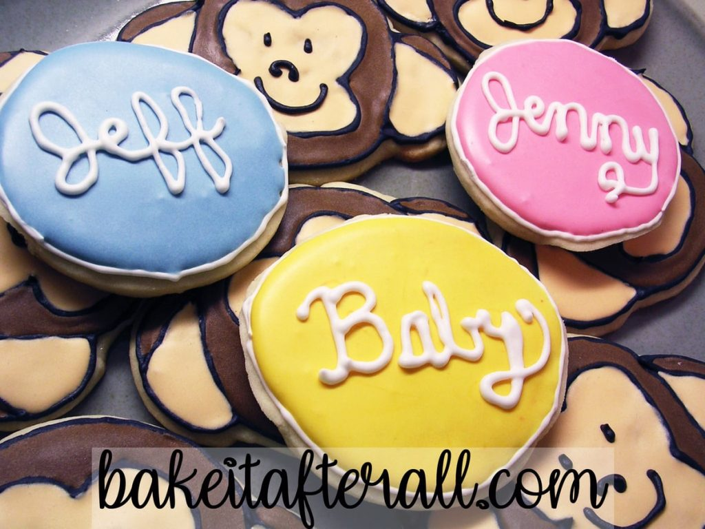 "Monkey Face Sugar Cookies with Royal Icing with round cookies that say ""Jenny,"" ""Jeff,"" and ""Baby""."