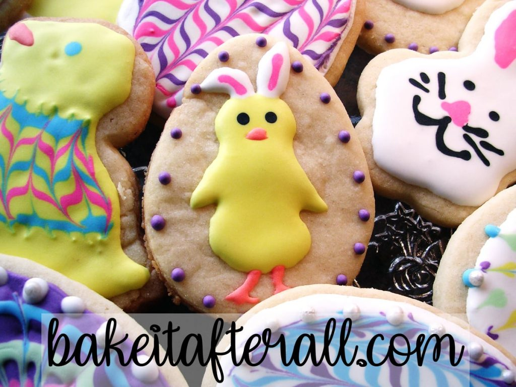 easter chick wearing bunny ears on a cookie