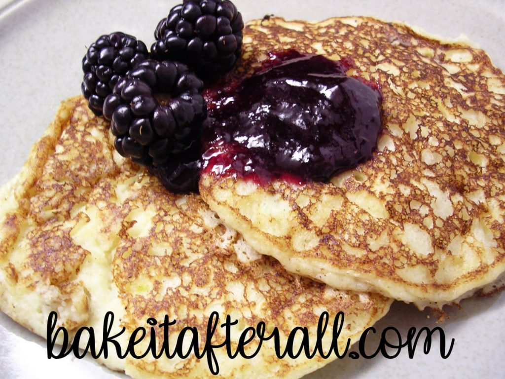 Lemon Ricotta Pancakes with blackberry syrup on top
