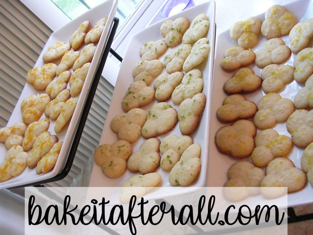 citrus glazed butter cookies on a 3 tiered serving platter