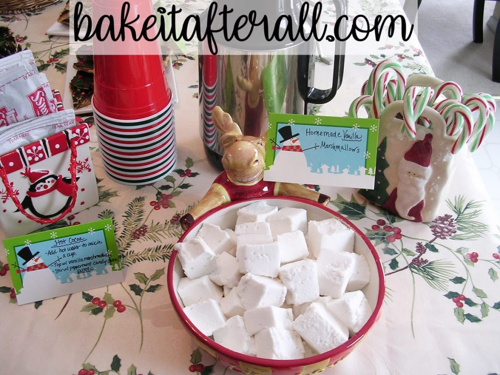 hot chocolate station featuring packets of hot cocoa, homemade marshmallows and candy canes for a Holiday Open House