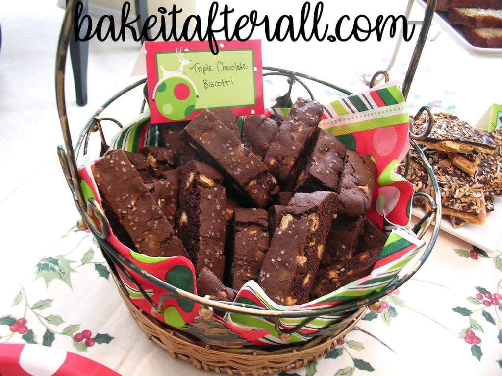 triple chocolate biscotti in a holiday basket on a holiday dessert table