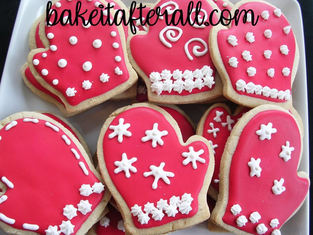 Brown Sugar and Spice Cookies shaped as mittens decorated with snowflake designs
