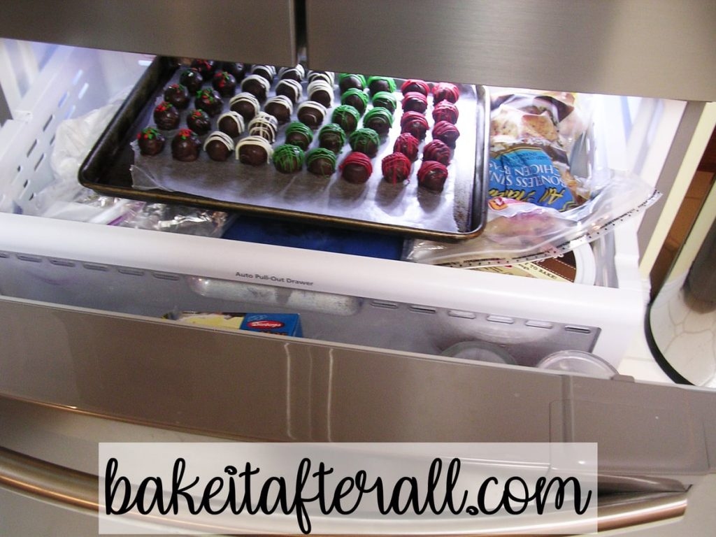 freezer drawer open containing a tray of homemade oreo truffles