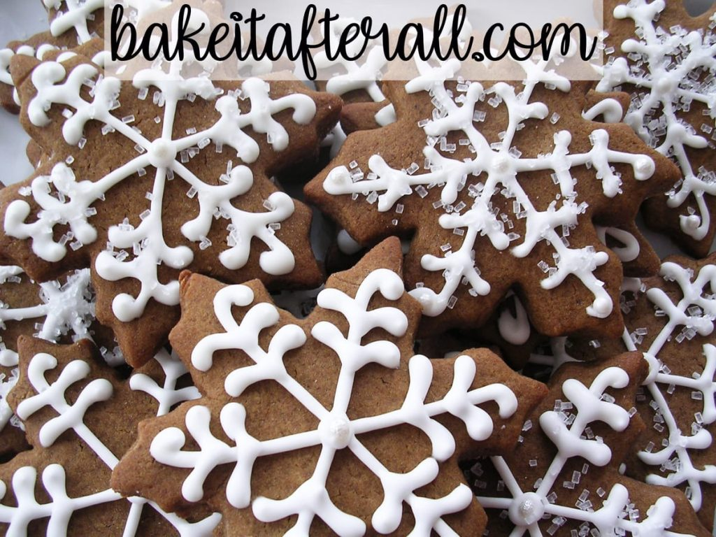 Snowflake Gingerbread Cookies decorated with white royal icing