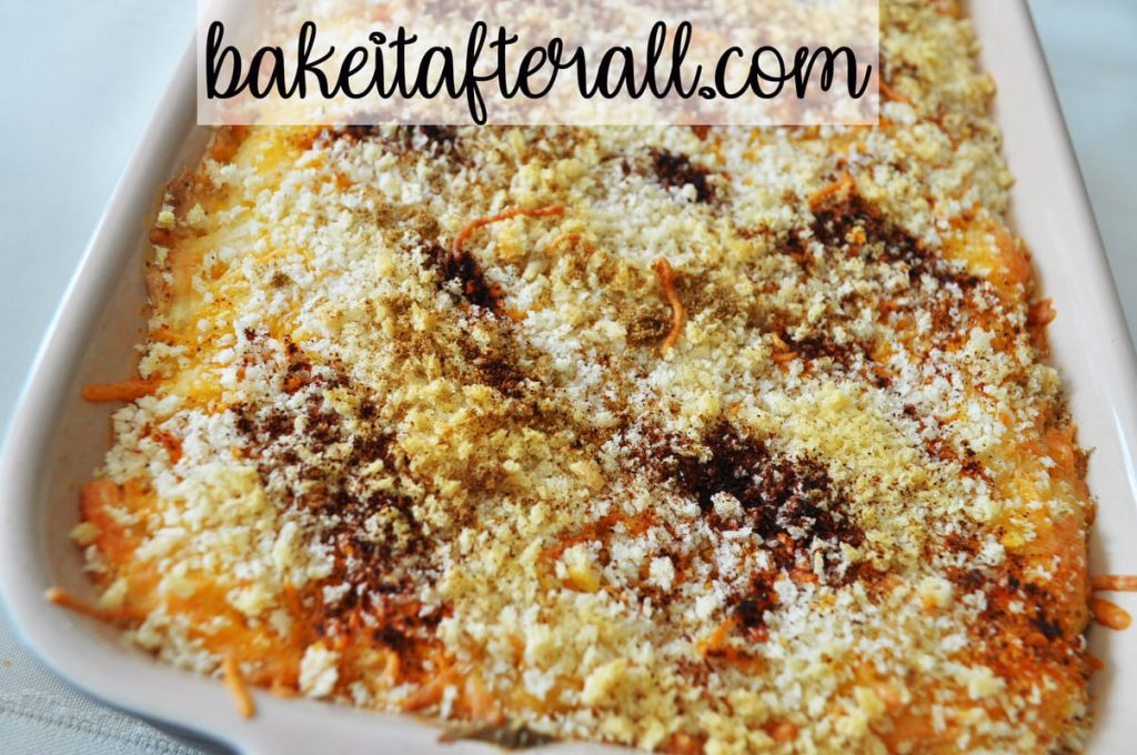 dish of dip baked with panko bread crumbs on top