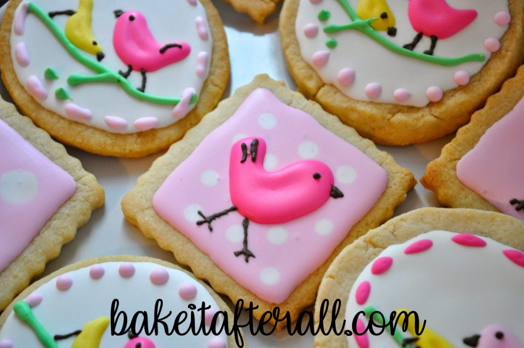 royal icing sugar cookies with cute birds on top