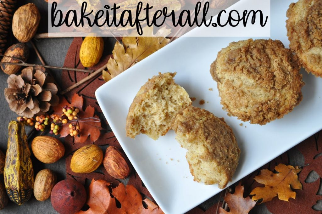 allspice crumb muffins on a plate surrounded by fall decor