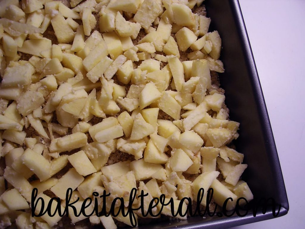 chopped apples layered in pan
