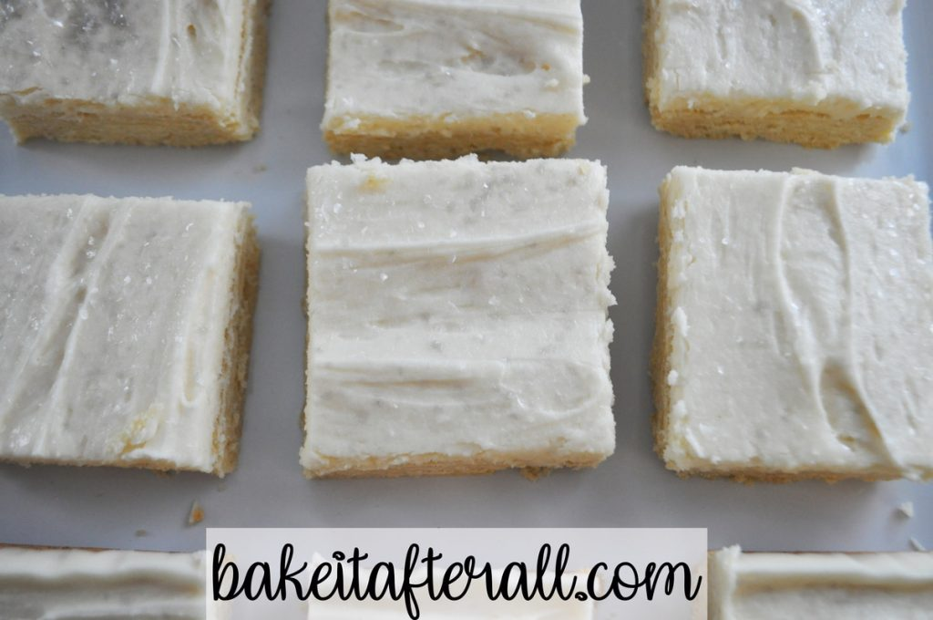 sugar cookie bars on a white plate