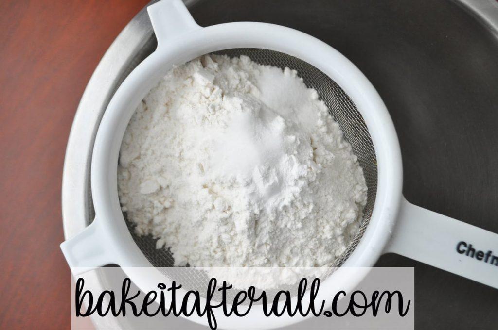 flour, salt, and baking powder in a small wire strainer