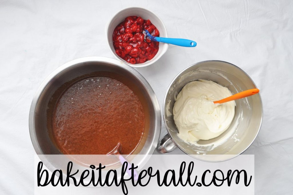 bowls of cherry pie filling, chocolate cake batter, cheesecake filling