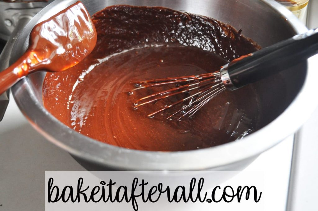 whisking chocolate mixture into egg mixture