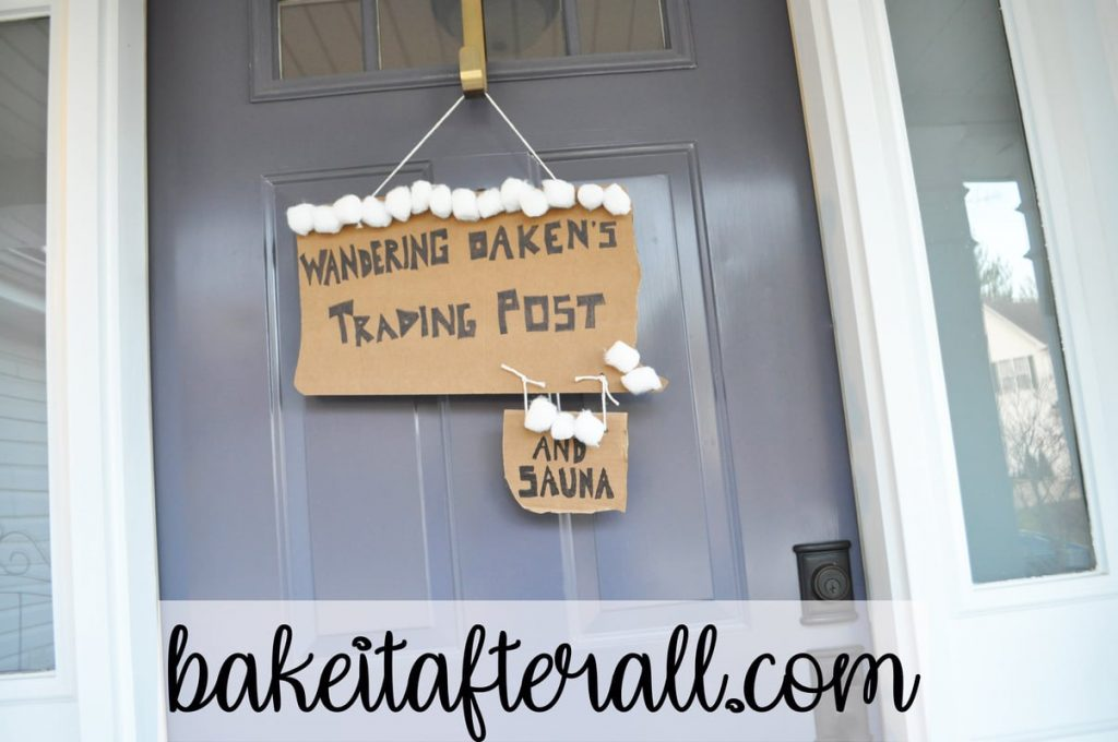 Wandering Oaken's Trading Post and Sauna cardboard sign hanging on front door