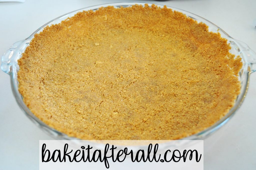 graham cracker crust in a glass pie plate