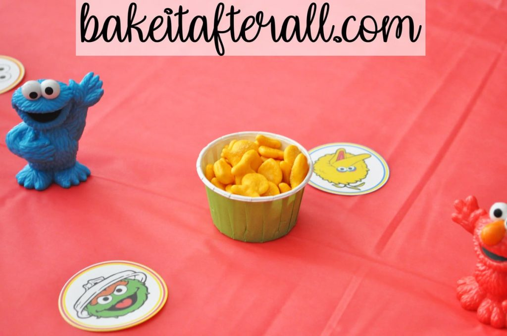 goldfish crackers in candy cup on table decorated for Sesame Street Birthday Party