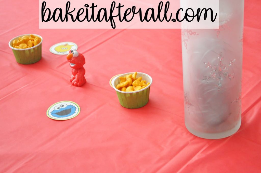 Sesame Street Birthday Party with Elmo figure and candy cups of goldfish crackers