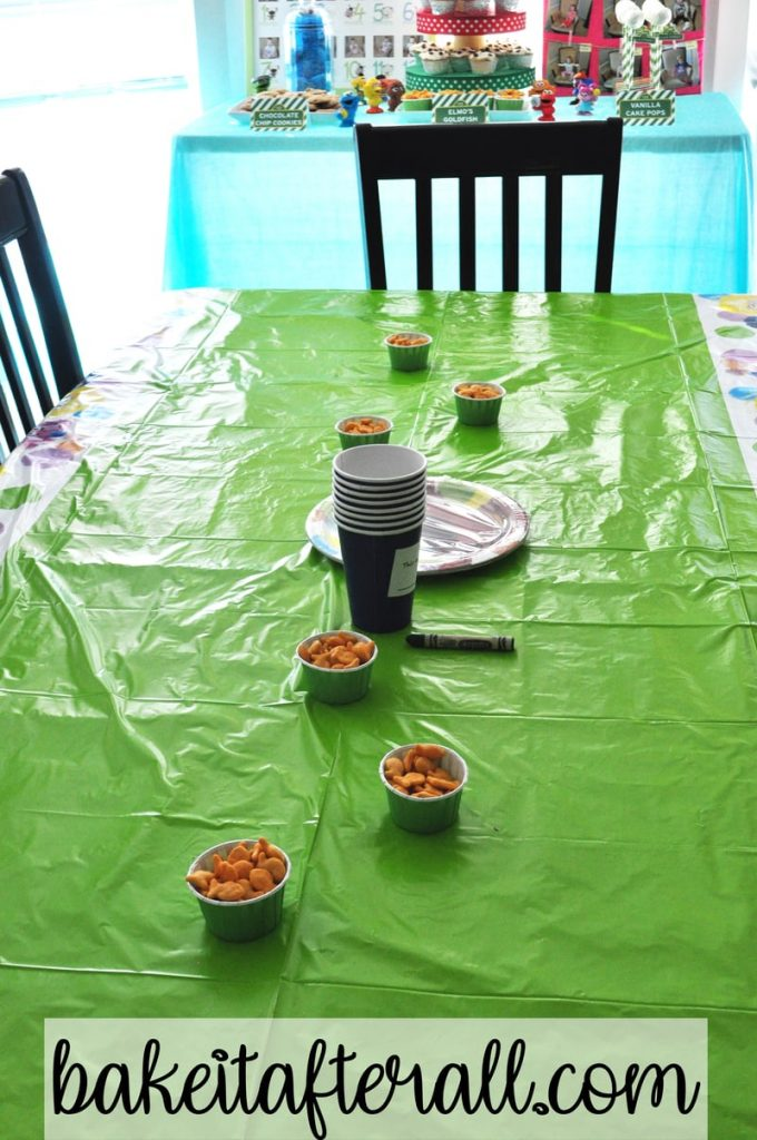 kids table decorated with goldfish crackers in candy cups