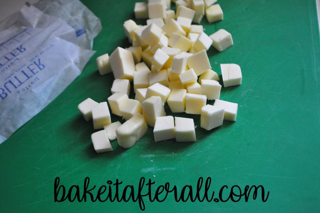 diced butter on a cutting board