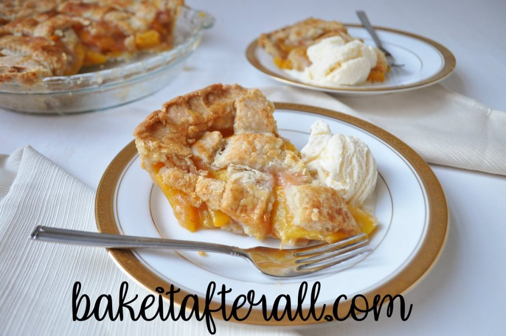 peach pie with ice cream on a plate with fork