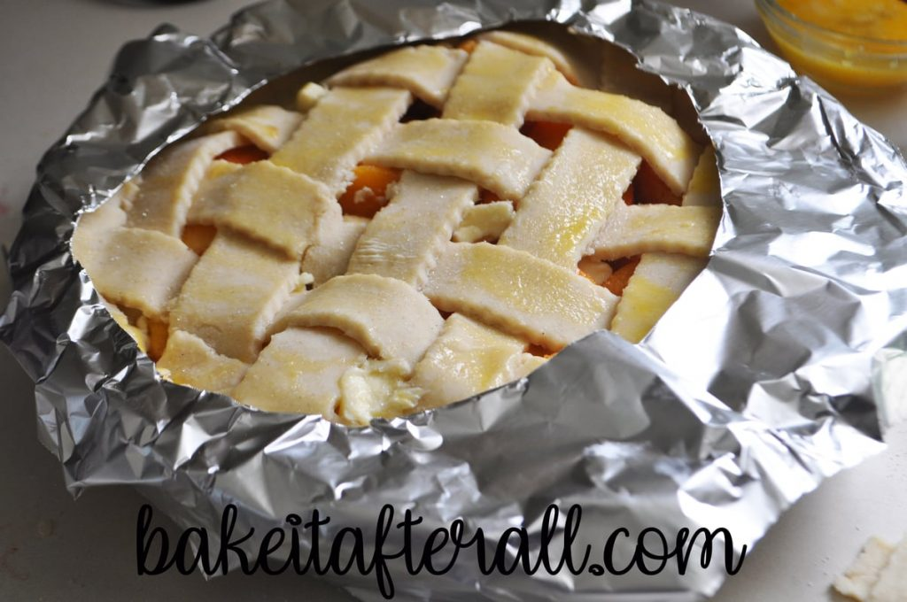 foil ring over the outer crust of peach pie to protect the edges before baking