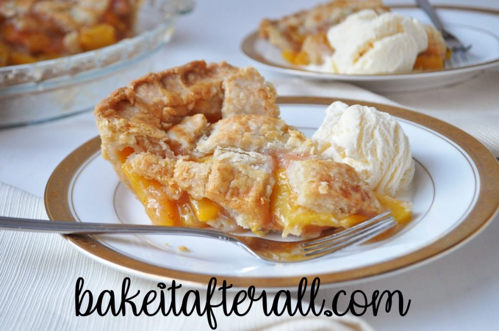 homemade fresh peach pie on a plate with vanilla ice cream