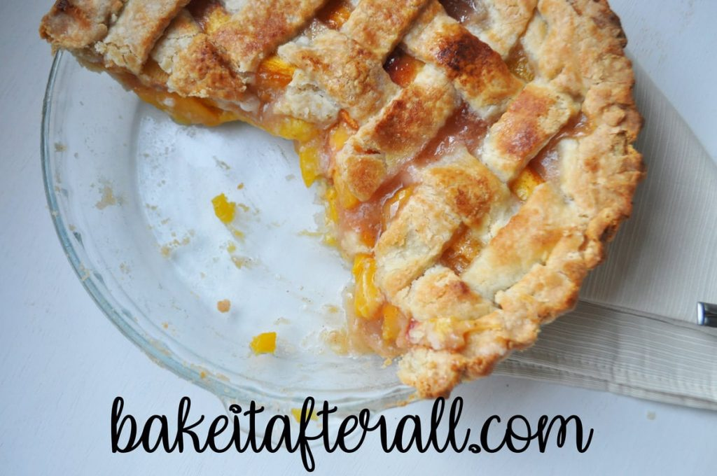 easy fresh peach pie in a glass pie plate with two slices removed