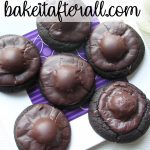 dark chocolate covered cherry cookies on a white plate