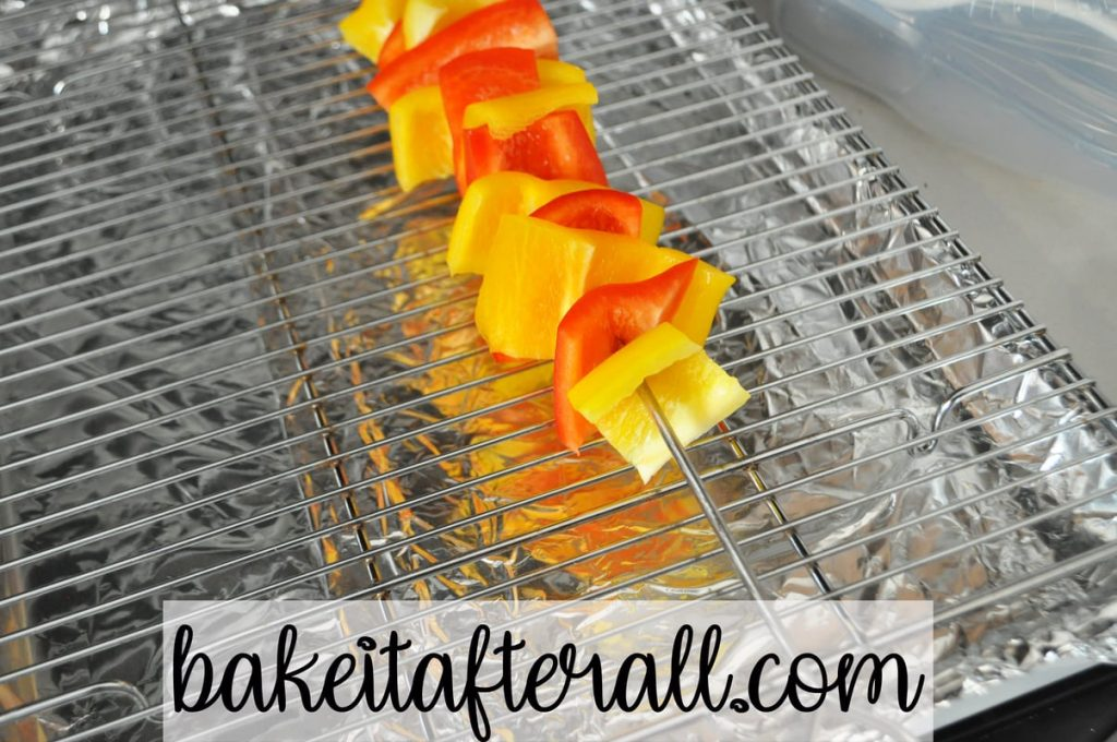 yellow and red pepper pieces on a metal skewer